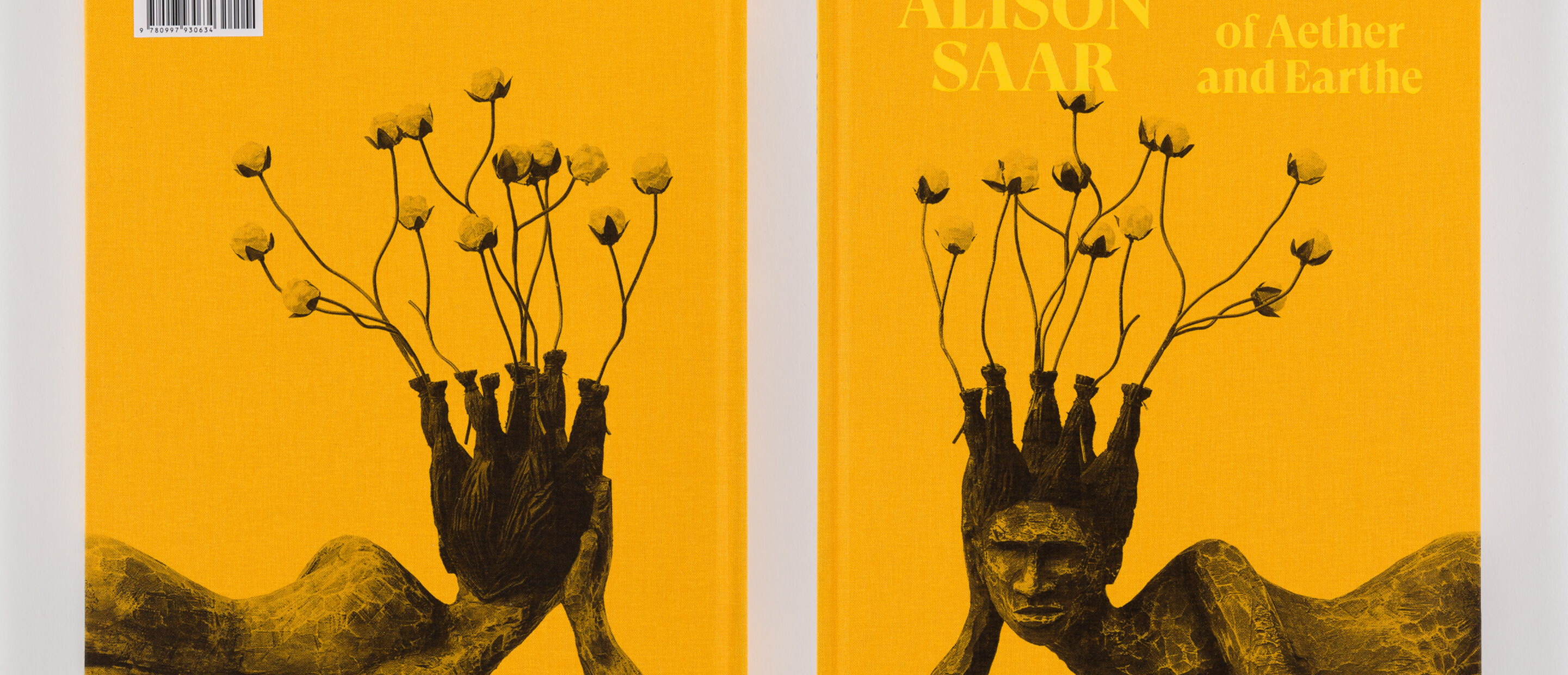 Photograph of both sides of a book titled Alison Saar: Of Aether and Earthe with image of sculpture front and back
