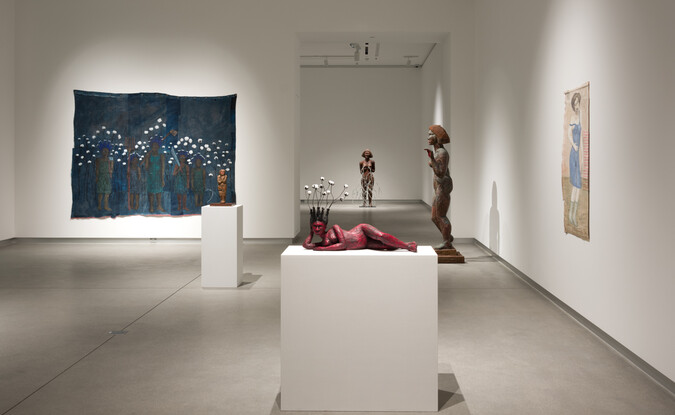Installation view of 3 dimensional sculptural and 2 dimensional works