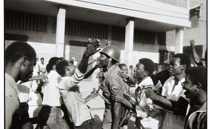 Danny Lyons, The soldier is greeted as hero. February 7, Port-au-Prince, 1983-86, Silver gelatin print, 8 1/2 x 13 in.