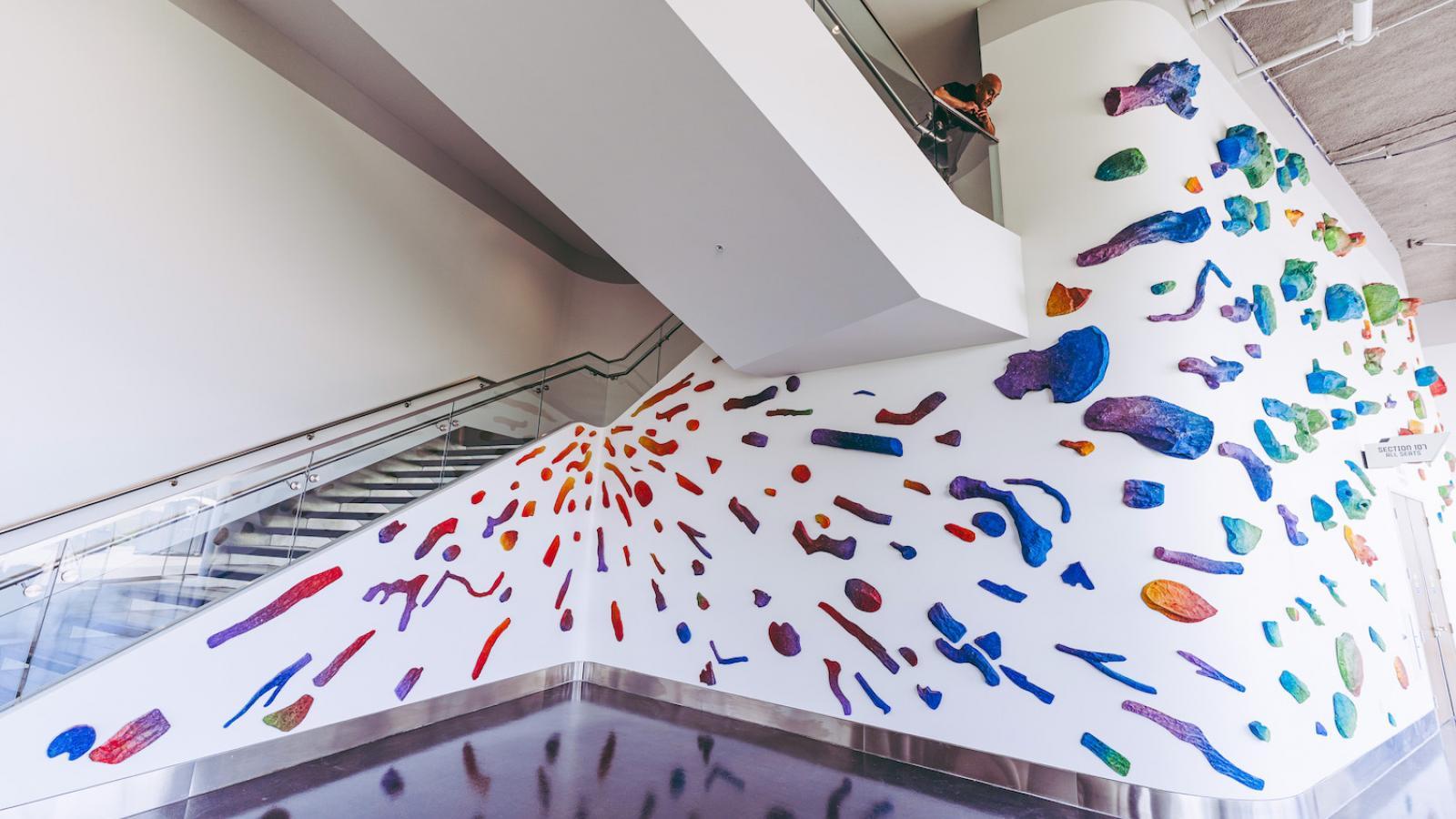 Pomona College Art Professor Sandeep Mukherjee looks down from stairway on his art installation at YouTube Theater.