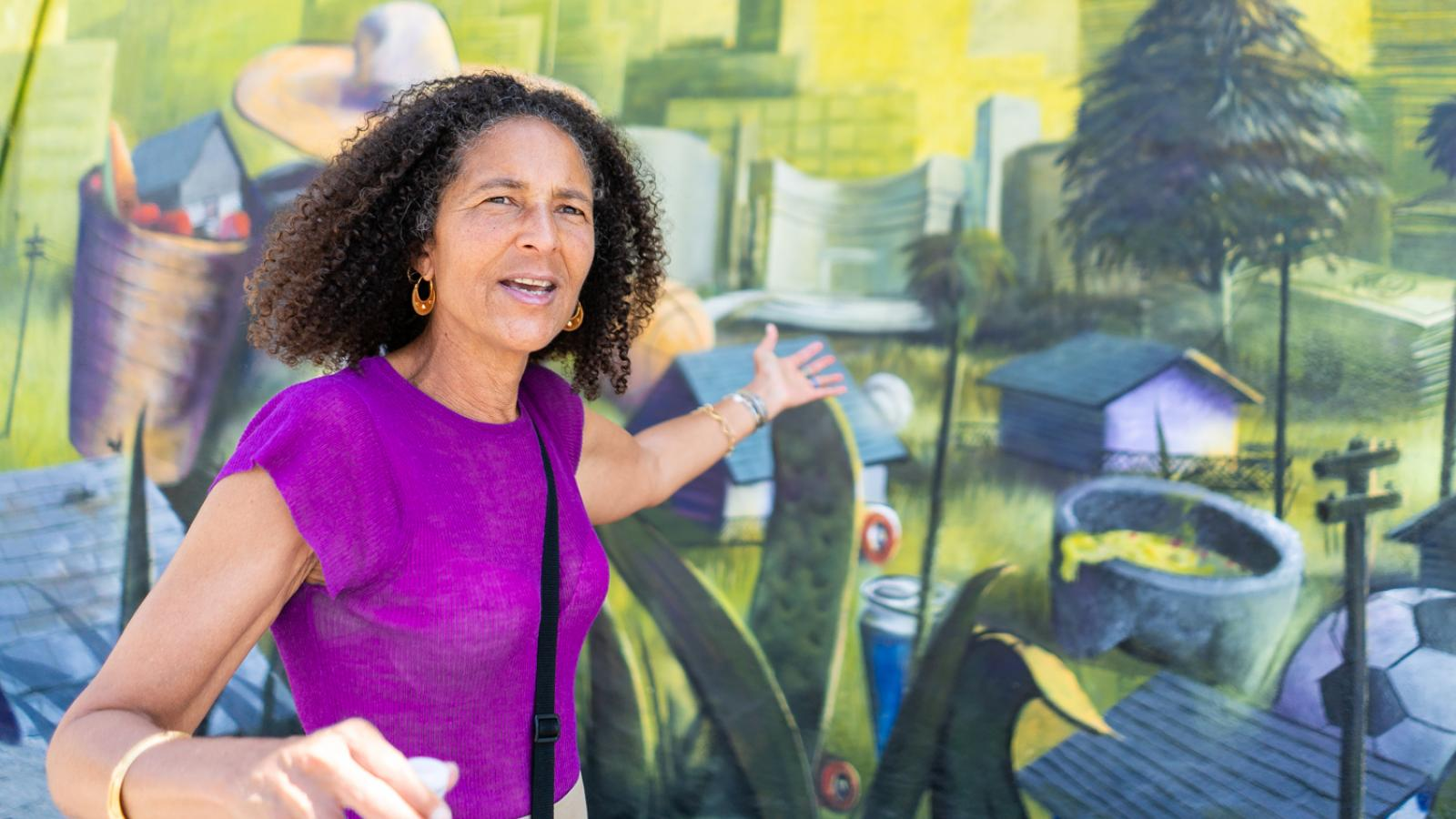 Alison Rose Jefferson stands in front on mural.