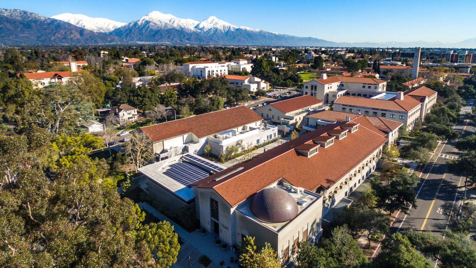 Drone view of roof of Millikan Laboratory with snowy mountains in the background.