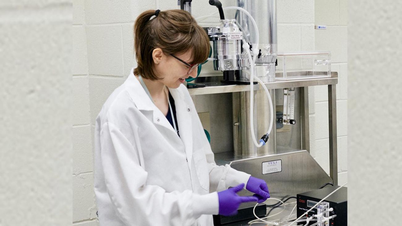 Hannah Caris in a laboratory.