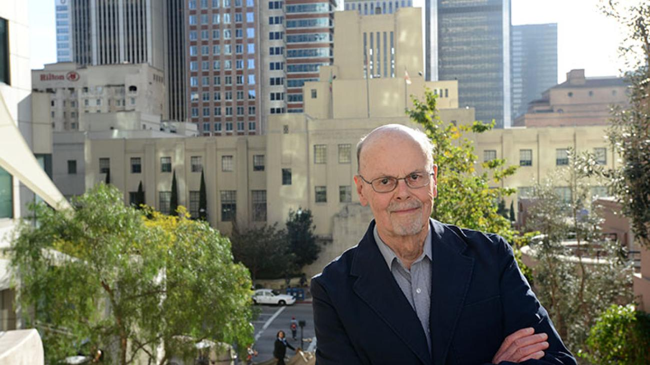Bob Herman in front of downtown L.A.'s Central Library