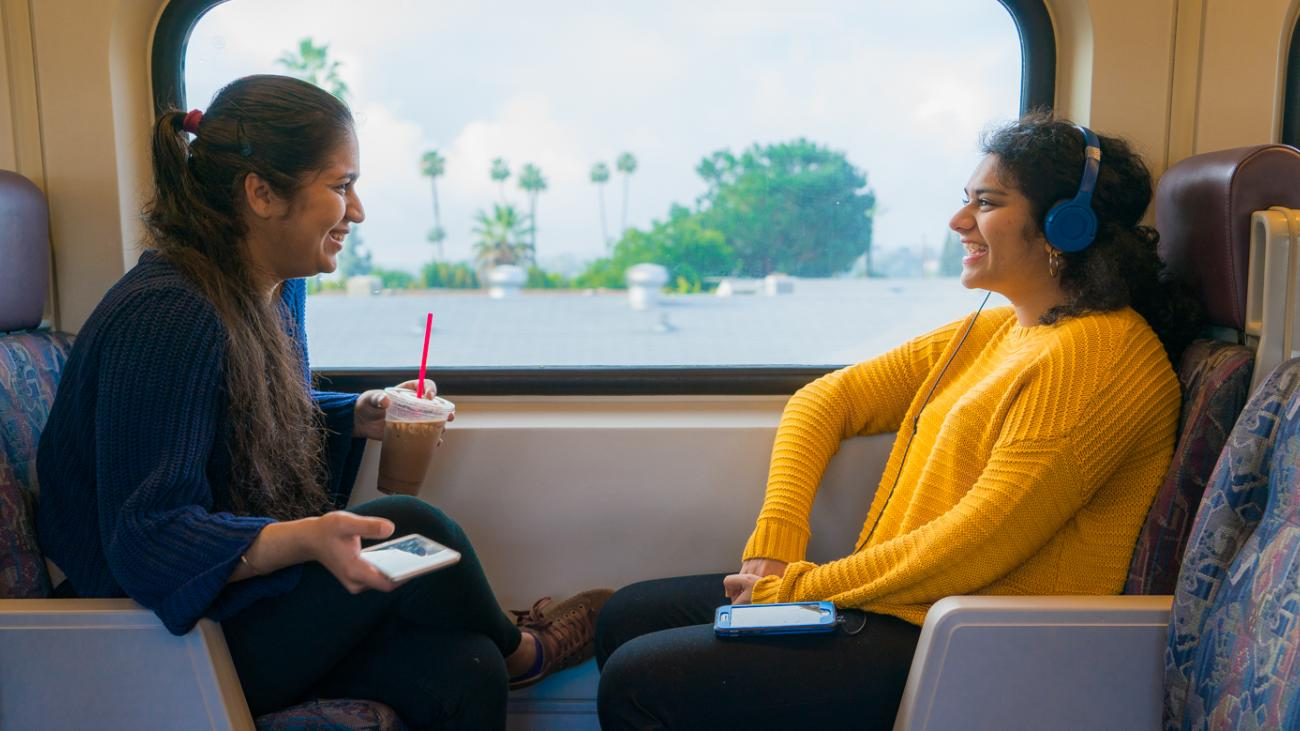 Noor and Tulika ride the train to LA