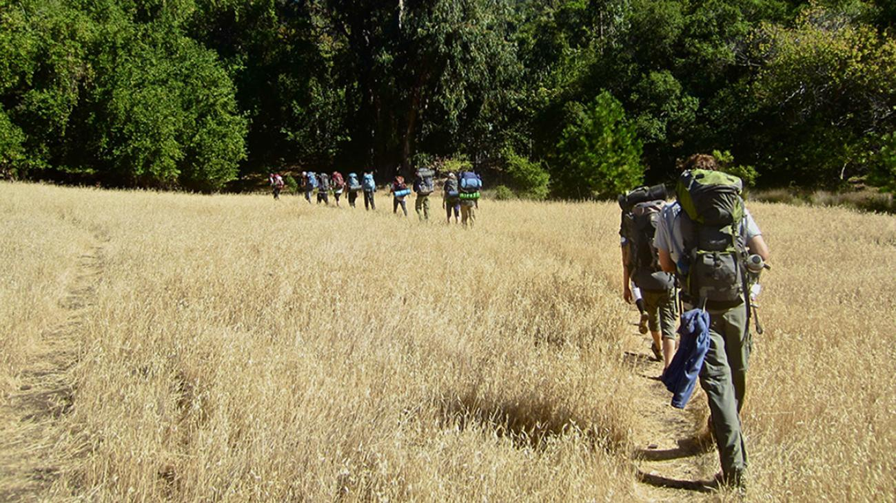 Students Hiking Across a Field