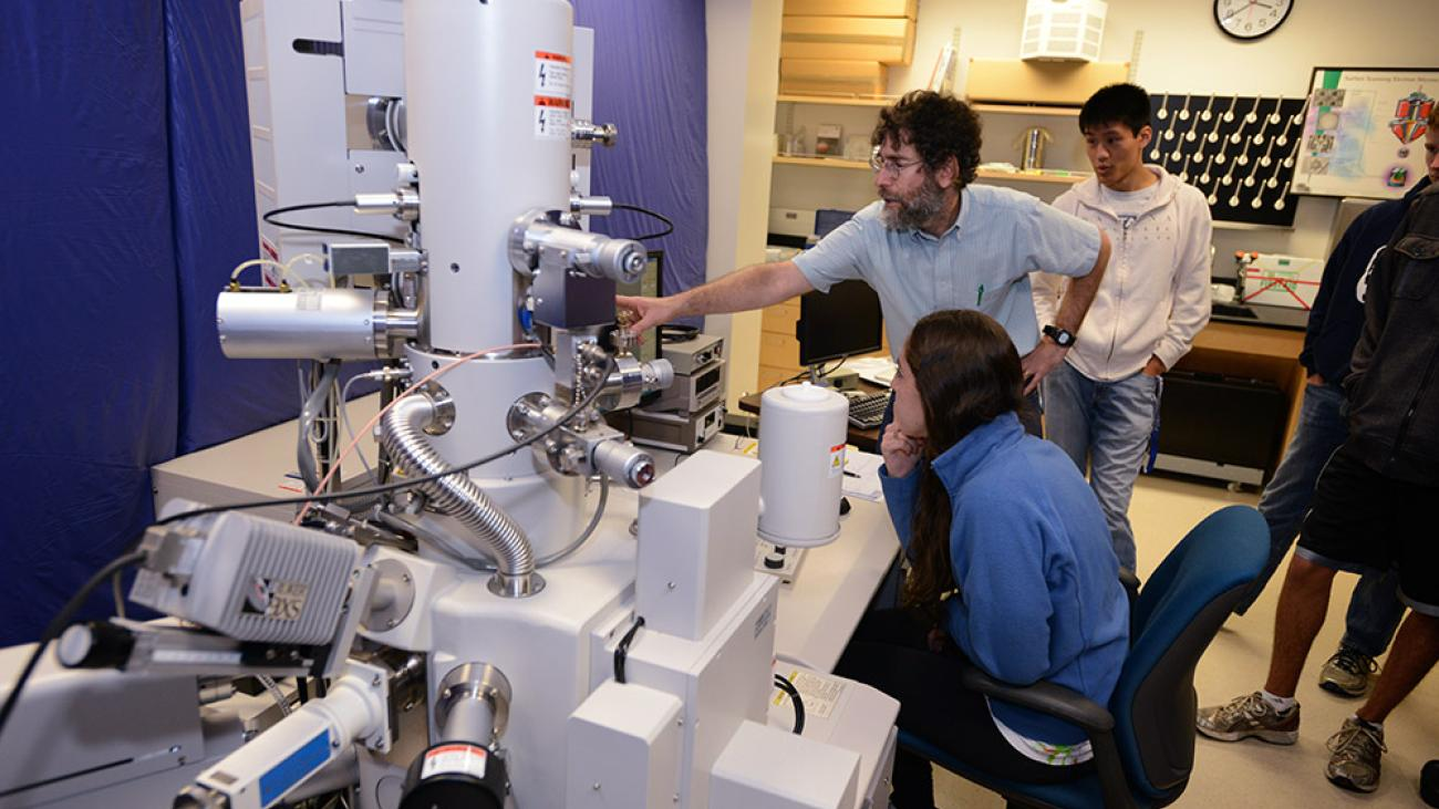 Professor David Tanenbaum with the scanning electron microscope